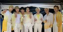 BTS Sowoozoo Concert group photo in yellow and white
